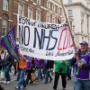 Health workers march in London to show support for the NHS as it celebrates its sixty-third birthday