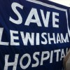 Hundreds gather in the rain at 'Born in Lewisham' protest against downgrade of hospital services
