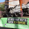 Crushed fly-tipper van goes on display
