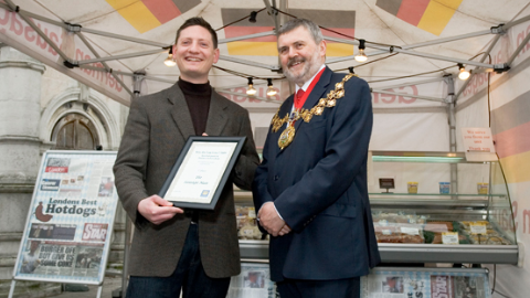 Last year's winner David Rundel, Owner of 'The Sausage Man', is being congratulated by Sir Steve Bullock, Mayor of Lewisham, during a mayoral visit to his stall. Photo: Flickr