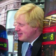 Mayor Boris Johnson peeks through mock-ups of new London bus design.  Photo: Tine Hvidsten