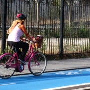 Another cyclist on the new blue-painted route. Photo: Steven Hampson.