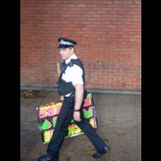 A policeman puts a stop to obscene placard bearing