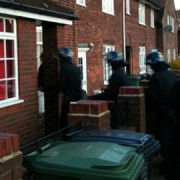Police raiding Mehmet's house in March 2011