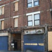 Shopfronts still damaged from the riots pic: Rosie Thompson