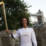 Double Olympic gold medallist Dame Kelly Holmes carries the Olympic Flame at Tower of London. Pic: www.london2012.com