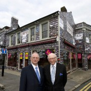 Maurice with his son Trevor in front of the Reeves store. Pic: Megan John