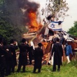 The Neturei Karta burning Israeli symbols Pic: Rabbi Beck