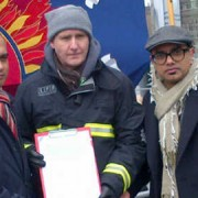 Cllr. Abdal Ullah and Murad Qureshi AM at the City Hall rally with a Bow firefighter. Pic: Tower Hamlets Labour Group