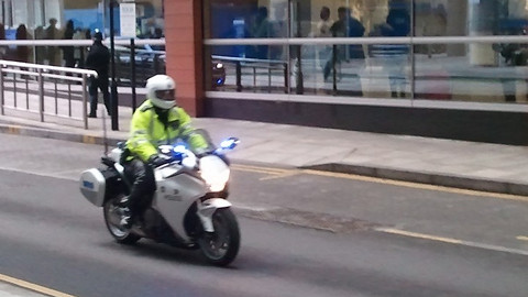 Police ahead of the Queen's car. Pic: Chris Dillon