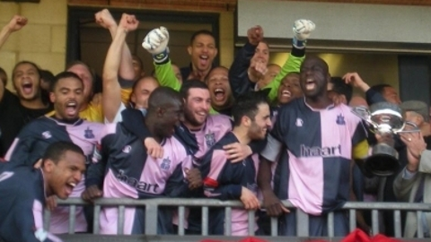 Dulwich Hamlet FC lift Division South Championship Trophy. Pic; Dulwich Hamlet FC website