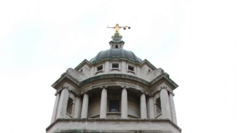 The Central Criminal Court, and dome with lady of justice at the top.