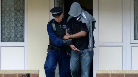 Met Police Trident Gang Command dawn raid arrest in Westminster. Pic: Met Police