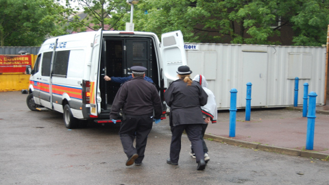 Man taken into custody for gang related activity Pic: Met Police