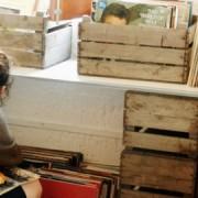 Rustic fruit crates containing vinyls. Photo: Sofi Donuts.