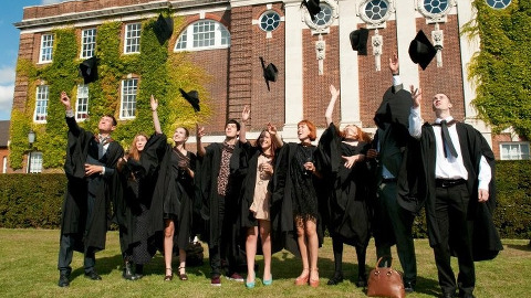 Goldsmiths students throwing their graduation caps in the air. Photo: GUoL.