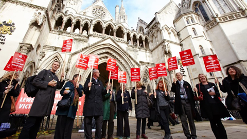 Campaigners celebrate their win outside the High Court. Pic: Simon Way