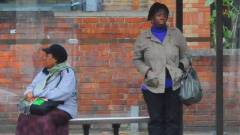 Two strangers at a bus stop. Pic: Polly Akhurst