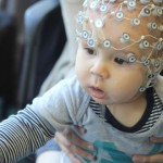 One of the babies in the research project wears the EEG sensor net. Photo: Goldsmiths