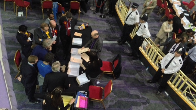 Candidates gather around to make sure that the count is right. Photo Andy Goddard