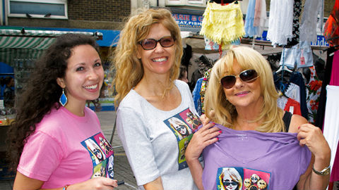 """June Bishop (right), winner of a """"Mince Pies- Eyes"""" t-shirt with two volunteers from Whitechapel Mission. Pic: Anne Clements"""