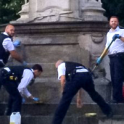 Police cleaning Lewisham Way war memorial. Pic: MPS Lewisham