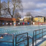 Swimmers enjoying the heated London Fields Lido on a winter day