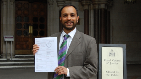 Green Party activist Shasha Khan holding the judicial review when it was first filed to the High Court of Justice. Pic: Stop the Incinerator Campaign