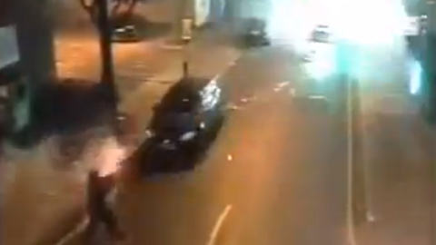 Man firing fireworks at a police vehicle. Pic: CCTV footage uploaded to YouTube by JakirAli1988