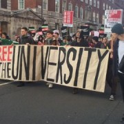 Students march with 'Free the University' banner. Pic: Kate Ng