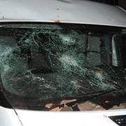 Damaged caused by tiles to police vehicle. Pic: Met Police