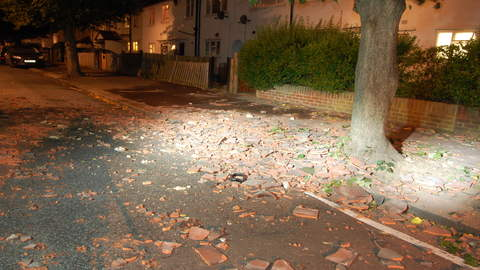 Roof tiles thrown at police and vehicles during nine hour stand off. Pic: Met Police