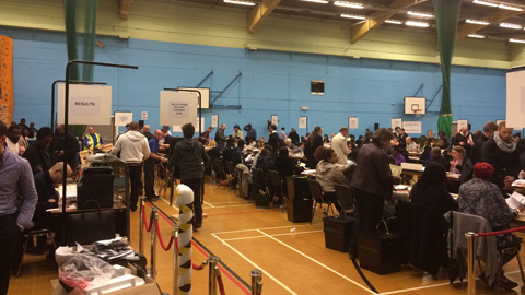 Officials count ballots at the Britannia Leisure Centre in Hackney a few moments ago