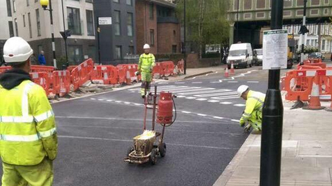 Workers put the finishing touches on the new pedi/cycle zebra crossing. Pic: Vincent Stops