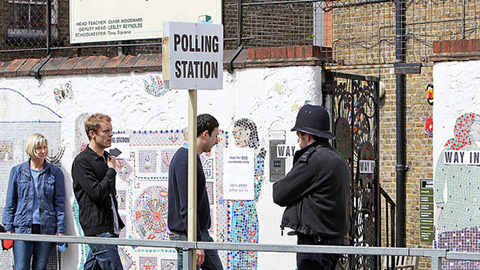A Tower Hamlets polling station guarded by a police officer during the last General Election. Pic: Tower Hamlets Council