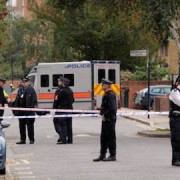 Police on the scene in Clarissa Street, Haggerston. Credit: SWNS