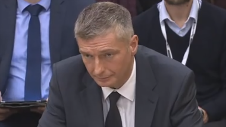 Mark Keary, the headmaster of Bethnal Green Academy, gives a speech in government. Pic Government.tv