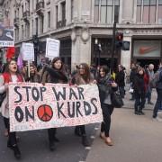 Marchers walk down Regent Street Pic: Lucy Domachowski