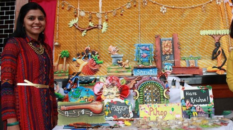 Komal Hoskati and her art stall at the Mela Pic: Pulaq Pathak