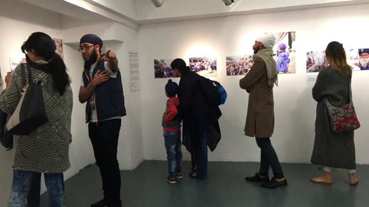 Visitors at the festival admiring the work. Pic: Shima Begum