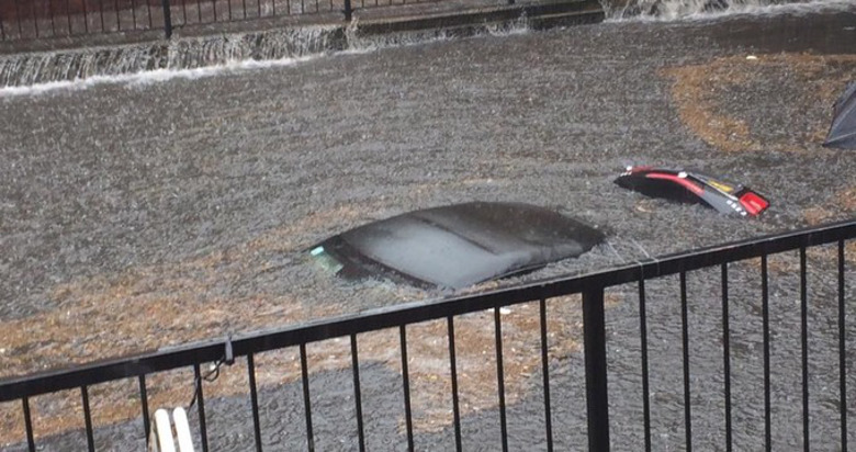 One of three cars which were submerged in Wallington Pic: Twitter/Paul Jolly