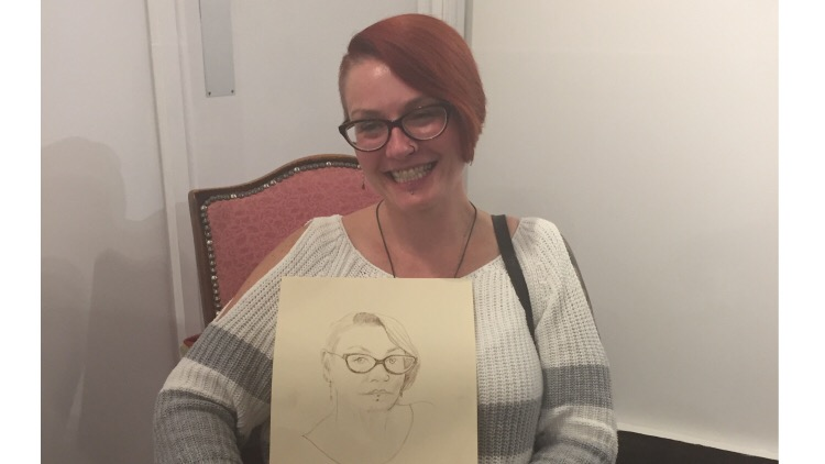 An attendee with her sketch. Pic: Phoebe Scott
