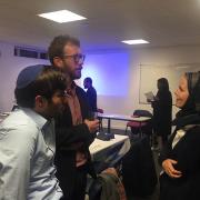Rabbi Natan Levy engaging with interfaith community at conference. Photo: Samra Said