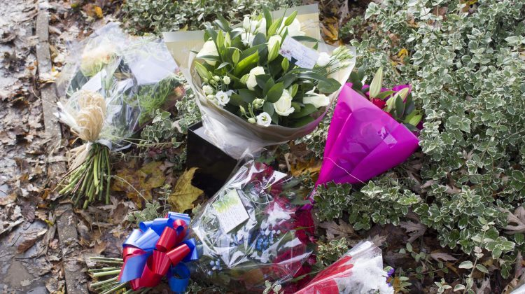 Flowers and tributes at the scene of the crash. Pic: Nick Dowson