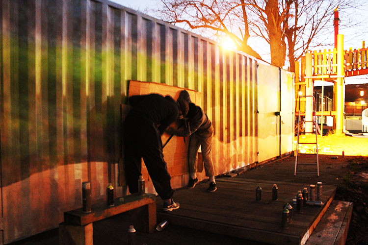 Volunteers spray-painted a new adventure playground for a youth centre. Pic: Marie Segger