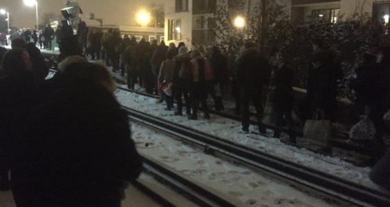 Passengers walking along snow-covered train tracks in Lewisham. Pic: Nina Bevan @ninaEbevan
