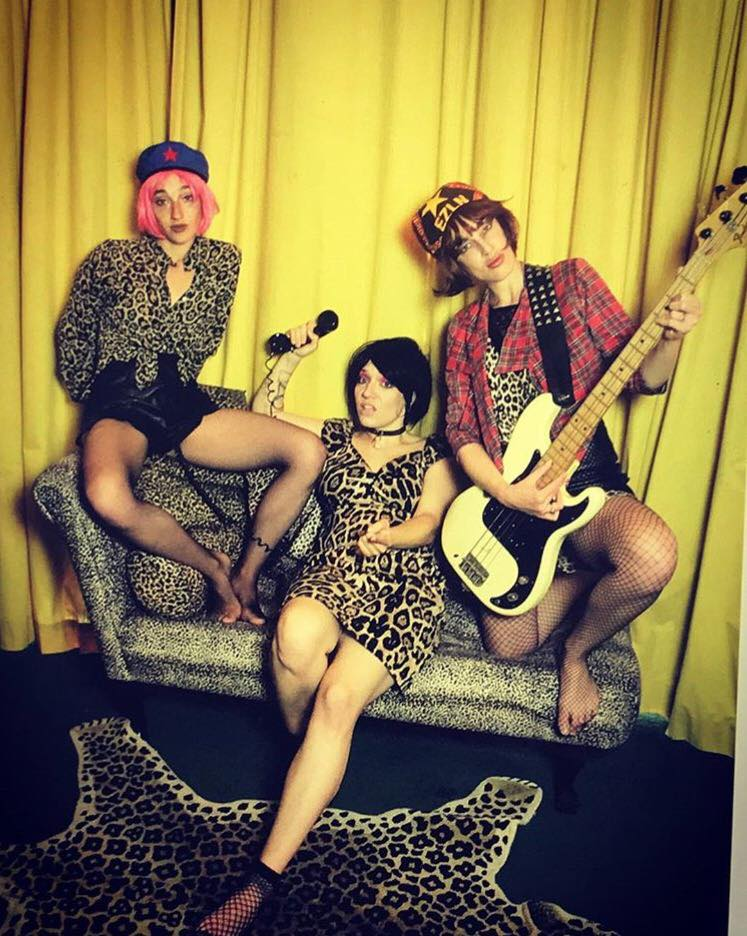 The full band posing in classic punk prints leopard, tartan, and fishnet. Pic: SH!TSICK Facebook page
