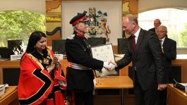 Commander John Ludgate (left) shaking Will Tuckley's (right) hand. Pic: Tower Hamlets Council