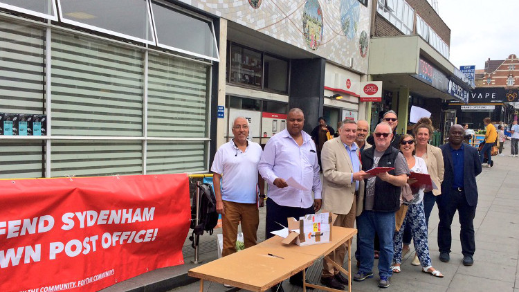 Campaigners outside the existing Sydenham Post Office site. Pic: Alan Hall