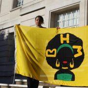 Malaika Parillon Langlais Baron holding her flag